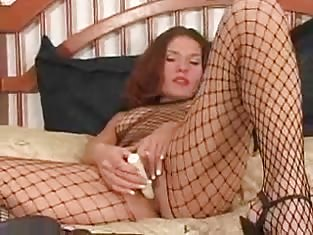 Girl in Fishnets Uses a Toy on Her Wet Pussy
