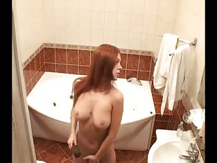 Busty Redhead Amateur About to Take a Bath