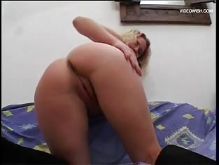 Wild Blonde Masturbates While Talking to a Man on the Phone