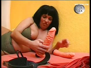 Big Titted Brunette Puts Her Sex Toy to Good Use