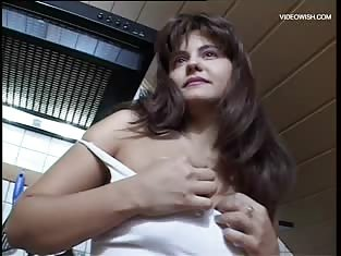 Naughty Brunette Strips and Masturbates in the Kitchen