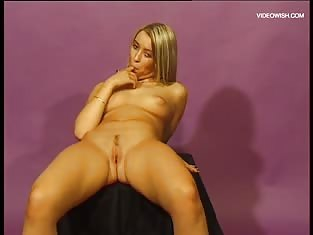Blonde Bends Over and Fingers Herself Deep