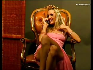 Blonde in Pink Starts to Masturbate