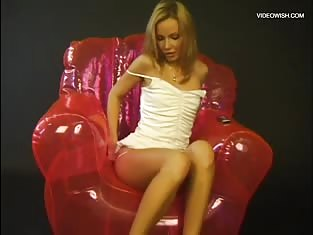 Blonde Girl on a Pink Blow Up Chair