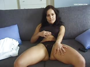 Girl in Thong Strips on the Couch
