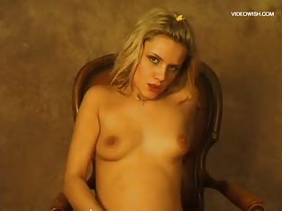 Small Titted Blonde in a Chair Playing With Herself