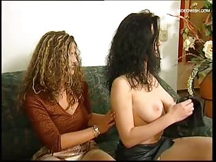 Two BIsexual Girls Toy on the Couch