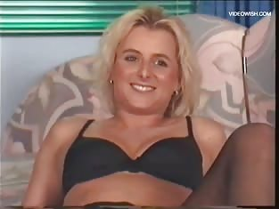 Blonde Smiles While Fucking Herself With a Vibrator