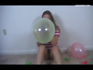Girl Blowing Up a Huge Balloon
