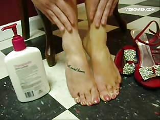 Cute Feet in Red High Heels Being Pampered