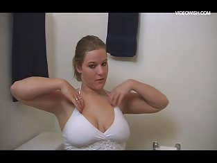 Busty Blonde Plays With Herself in the Bathroom