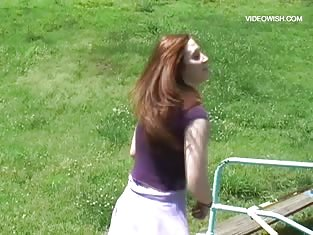 Horny Redhead Has Some Fun While She's at a Playground
