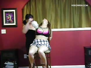 Brunette Tortures Her Busty Friend with a Feather Duster